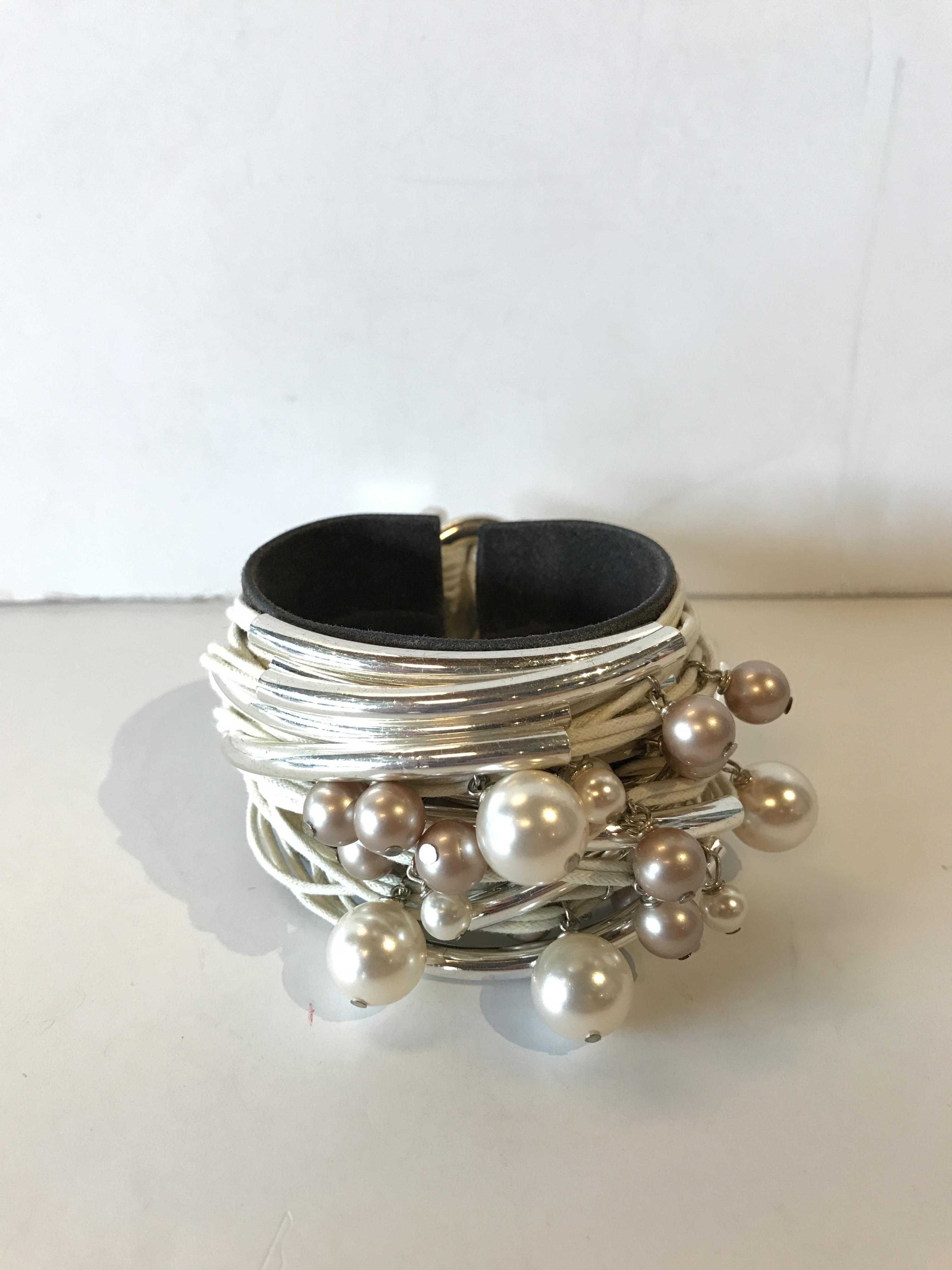 Cream multi strand with silver and Bracelets Price: $186.99