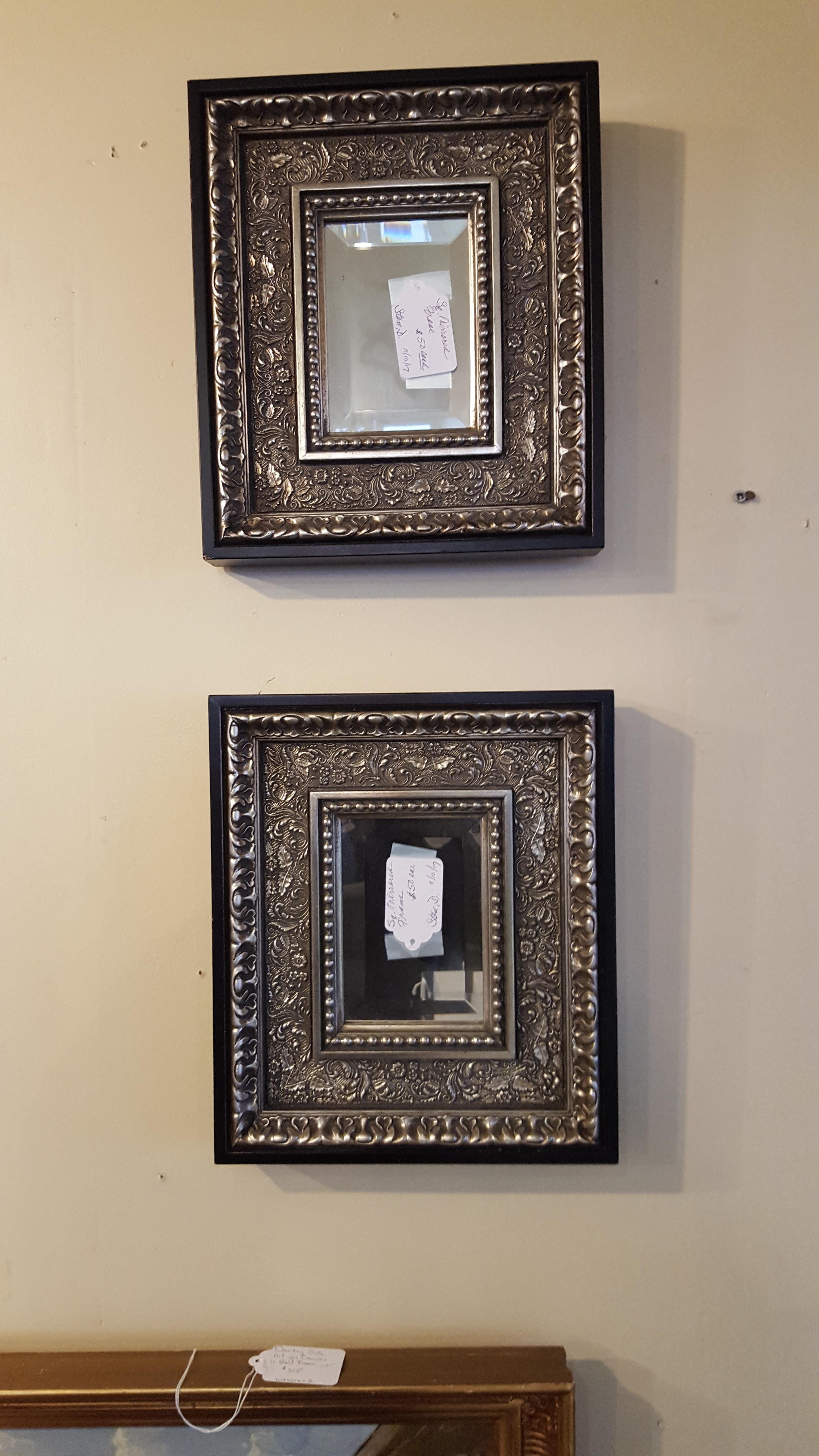Beautiful pair of hand carved black and Artwork, Mirrors Price: $100.00
