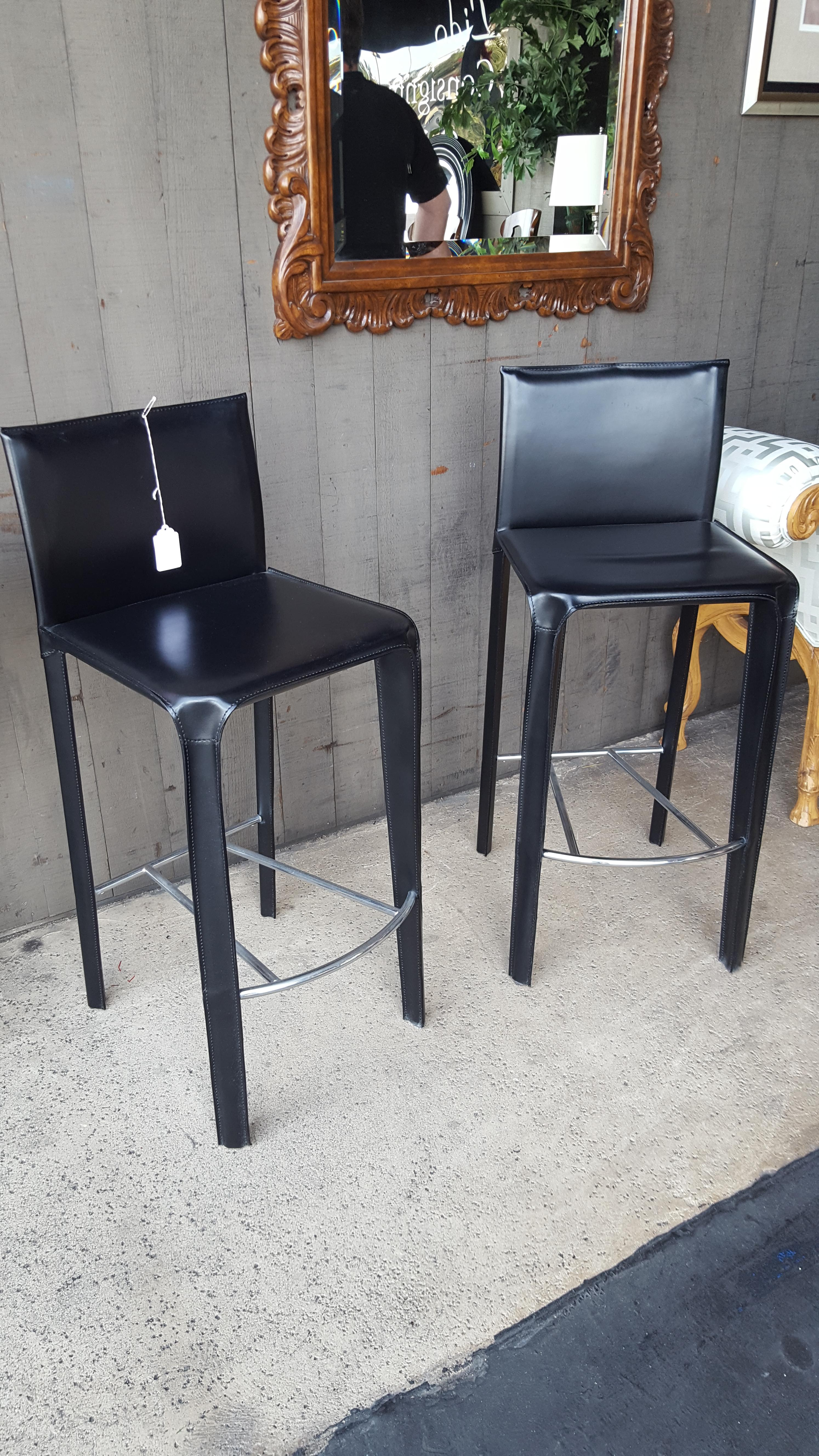 Pair of Arper black Italian Leather Chairs, Benches, Stools Price: $850.00