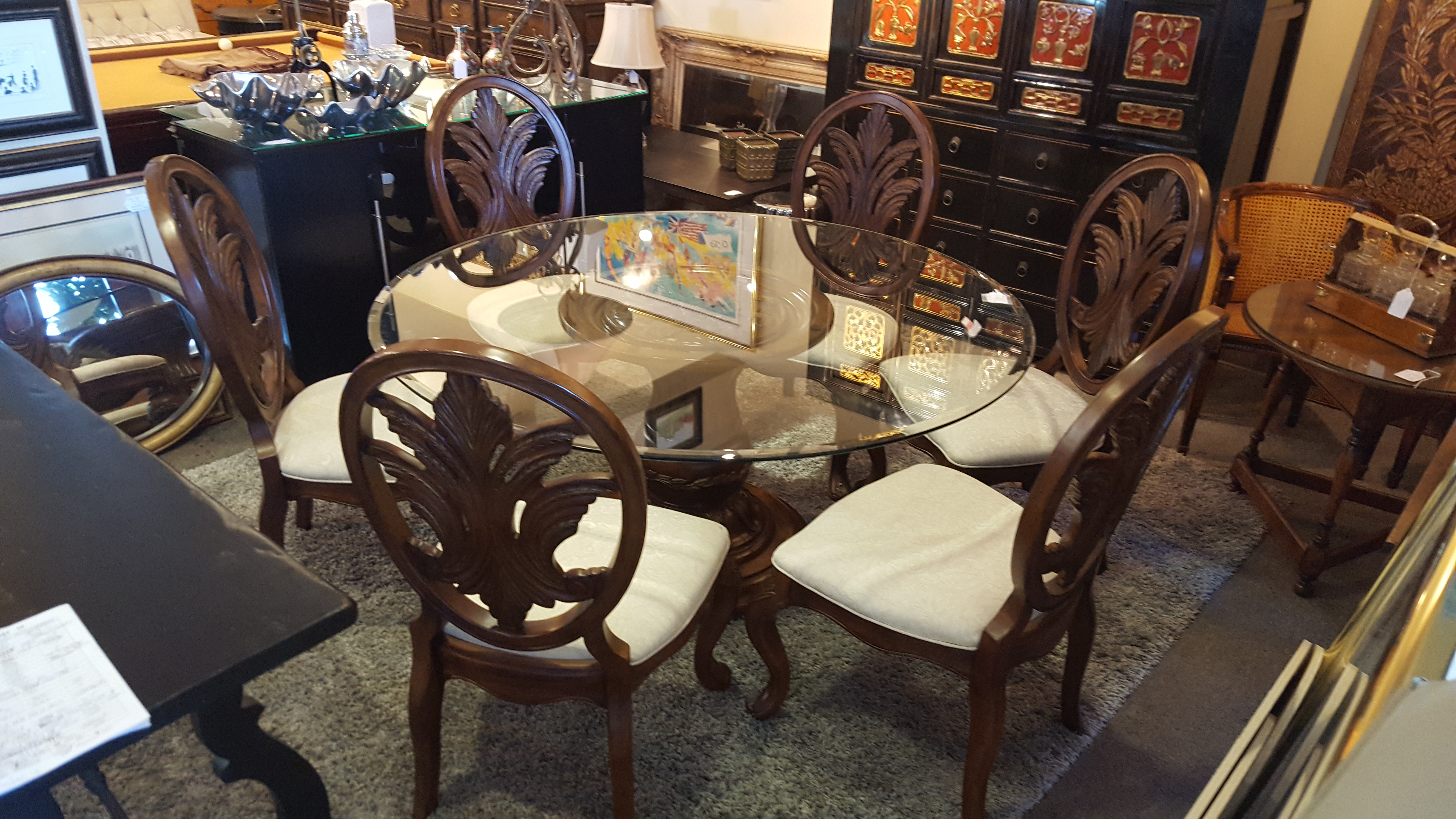 Beautiful 60 round glasas top dining Dining Price: $895.00