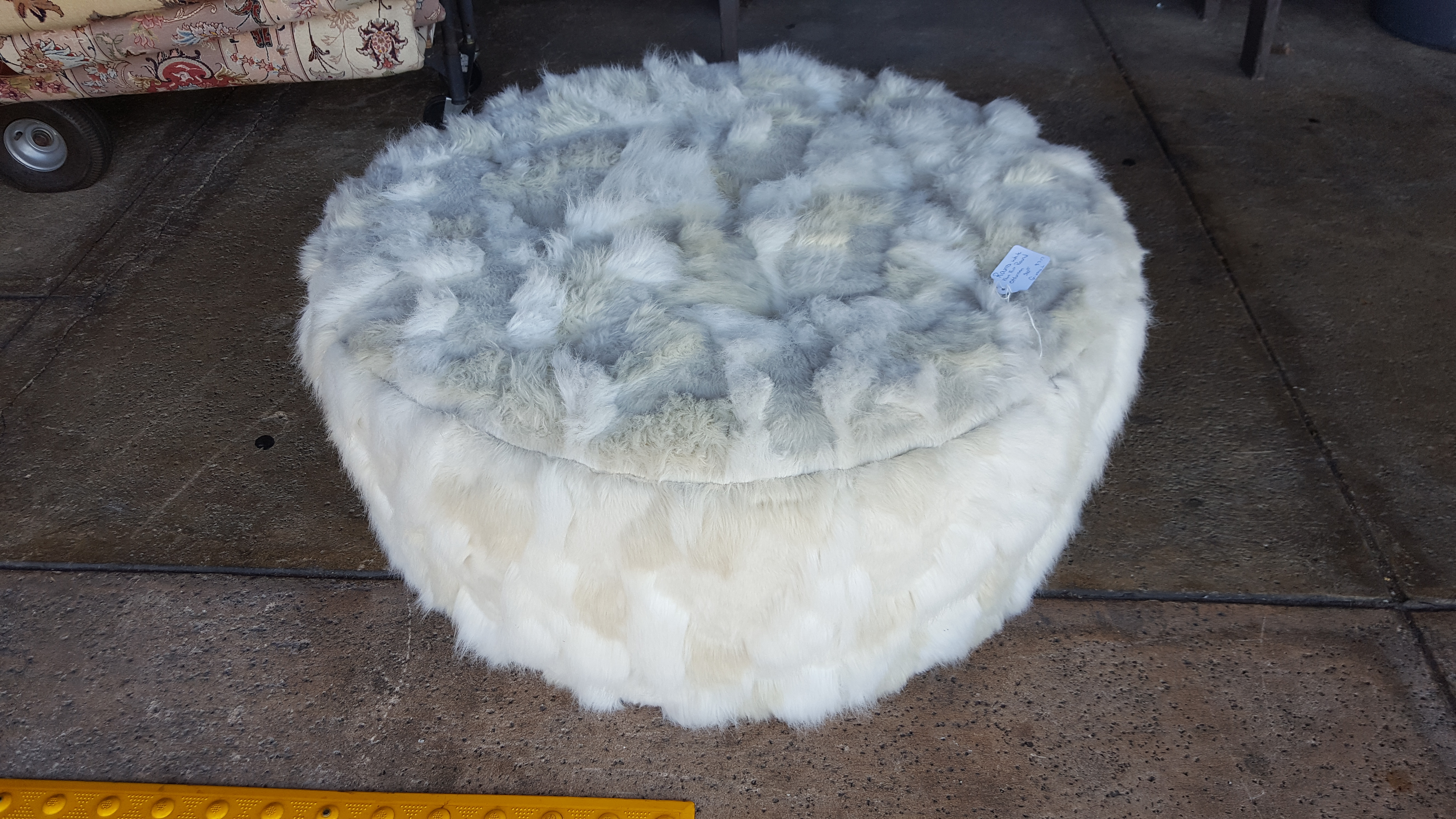 Faux Furr round upholstered Ottomans Price: $315.00
