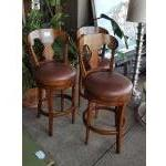 Set of 3 mahogany finished counter swivel stools with brown leather seats. For Sale