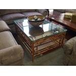 Very coastal, glass top coffee table with leather wrapped bamboo base. For Sale